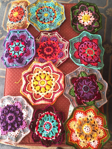 crocheted motifs for a blanket all laid out-color photo