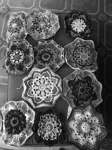 the same photo of crocheted motifs in black and white