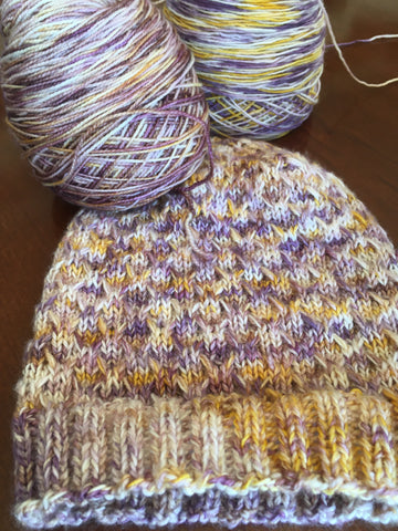 Purple and yellow hat using Ice Time pattern