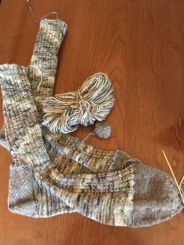 Green and gray variegated socks with gray toes and heel.