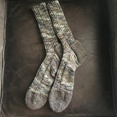 green and gray variegated socks with gray heel and toes