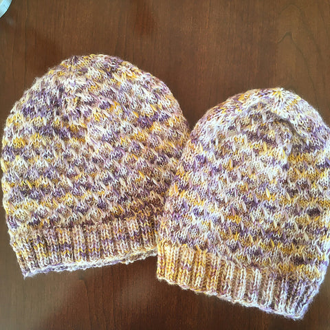 a pair of purple and yellow variegated Ice Time Hats