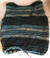 Dark green and teal striped sweater, partially finished.