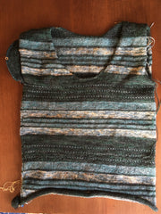 dark green and light teal striped tee with one sleeve barely started