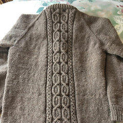 cabled detail on back of brown sweater