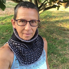 short-haired woman wearing a blue and gray Dissent Cowl in honor of RBG