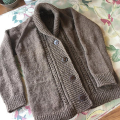 front detail of brown sweater showing 1 inch buttons