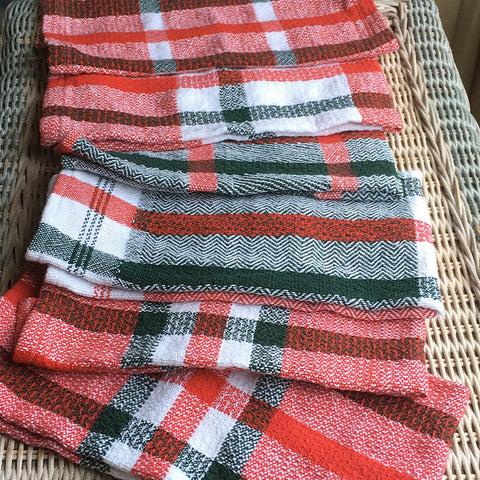 red and green handwoven dishtowels
