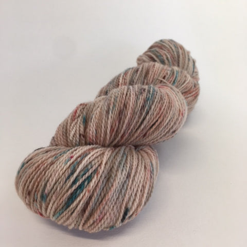 Rambouillet fingering weight yarn in pale brown with speckles.