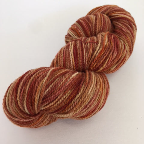 Rust and brown variegated Rambouillet yarn