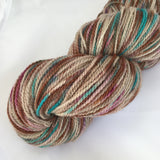 Skein of brown, teal, and magenta variegated yarn