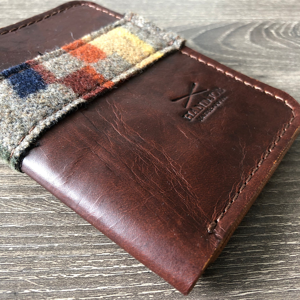 Upright bifold leather and fabric wallet