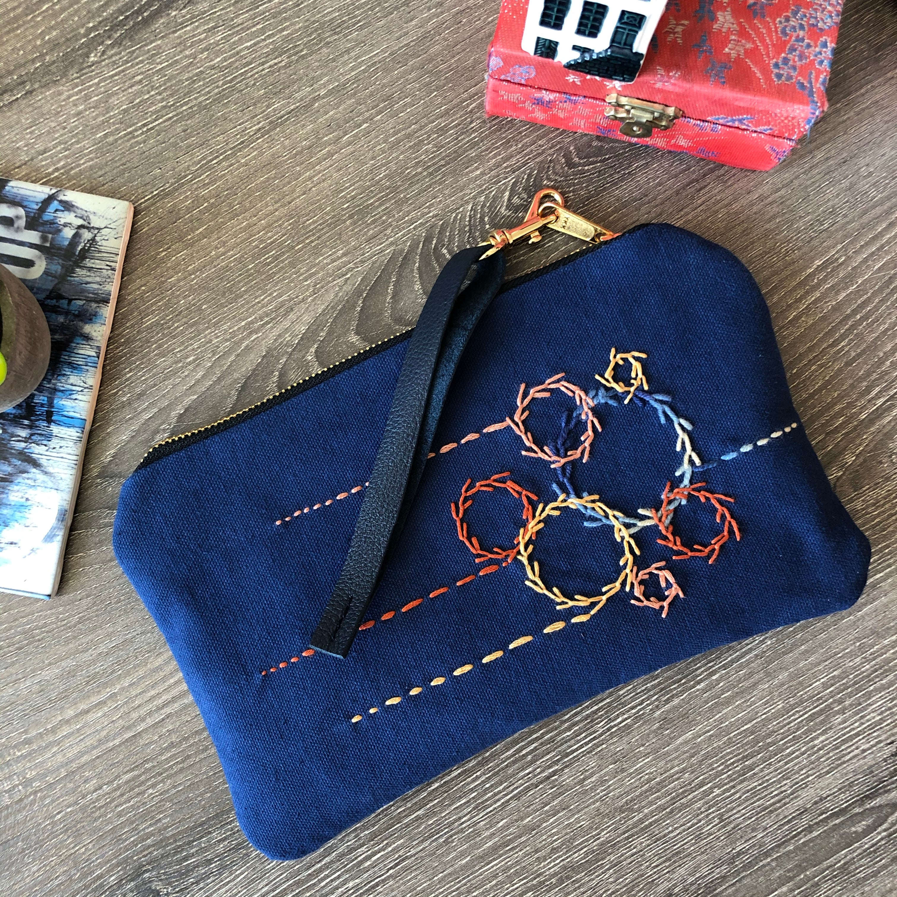 Embroidered Circles Navy Leather Clutch