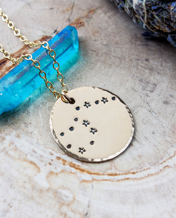 This glowing gold Aquarius star sign constellation necklace will remind ...