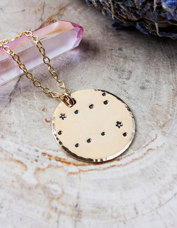 This glowing gold constellation necklace will remind you that you are ma...