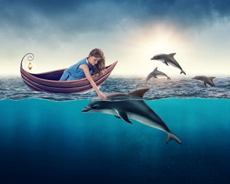 Girl with dolphins