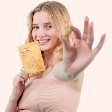 Girl with Cell Soldier Supplement holding capsule