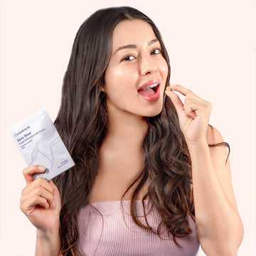 Girl with Berry Blast Supplement holding tablet