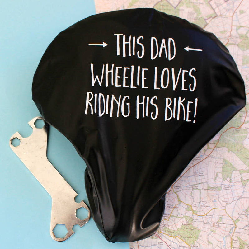 'This Dad Wheelie Loves Riding His Bike' Bike Seat Cover | Kelly Connor Designs