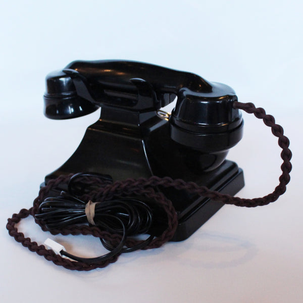 An original GPO telephone in black bakelite. With integral drawer at Jeroen Markies.