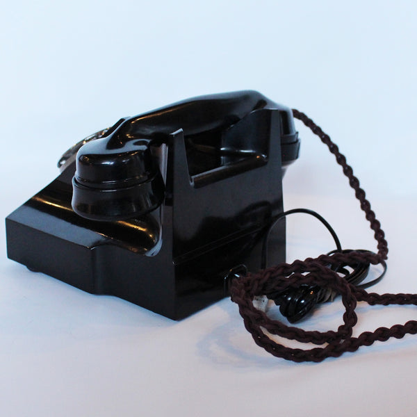 An original GPO telephone in black bakelite. With integral drawer.