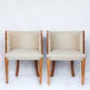 A pair of Art Deco tub chairs. Veneered walnut wrap frame. Solid satin birch legs. Upholstered in cream leather at Jeroen Markies.