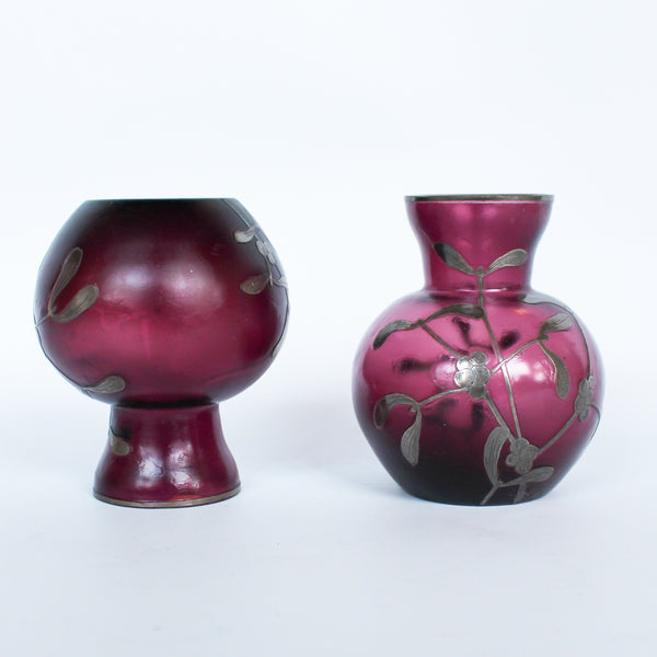 A pair of Art Deco bohemian purple hued glass vases with silver overlay mistletoe design at Jeroen Markies