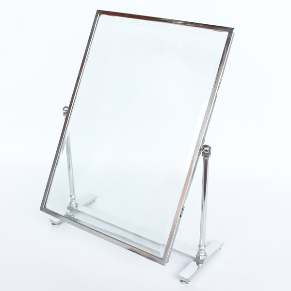 An Art Deco photo frame, on a chrome base, beveled glass liners at Jeroen Markies.