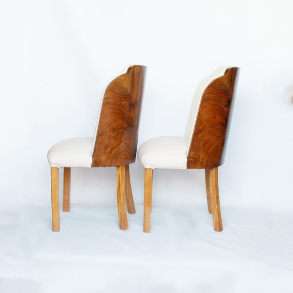 A pair of walnut backed, Art Deco cloud chairs by Harry & Lou Epstein at Jeroen Markies