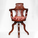 A solid, carved, walnut bar chair from HMHS Britannic, sister ship to the Titanic at Jeroen Markies.