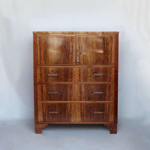 An Art Deco chest with cabinet to top in figured walnut at Jeroen Markies