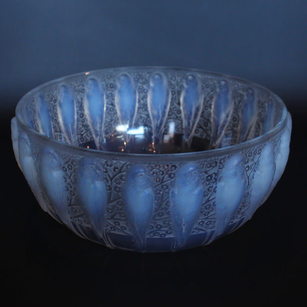 A frosted an opalescent glass bowl depicting parakeets in relief. Hand etched 'R Lalique France' to underside at Jeroen Markies