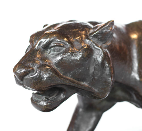 An Art Deco, patinated bronze study of a prowling tiger, set over an integral marble base. Signed to marble at Jeroen Markies