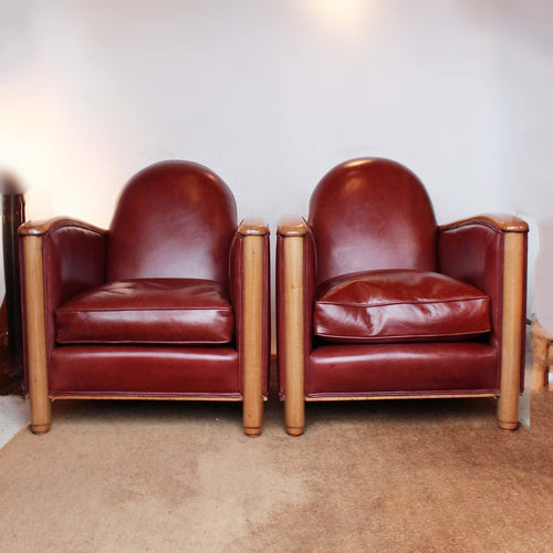 Art Deco tub chairs with fruit wood arms upholstered in chestnut leather at Jeroen Markies