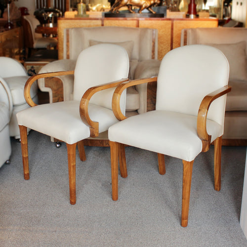 A pair of Art Deco side chairs with curved walnut arms