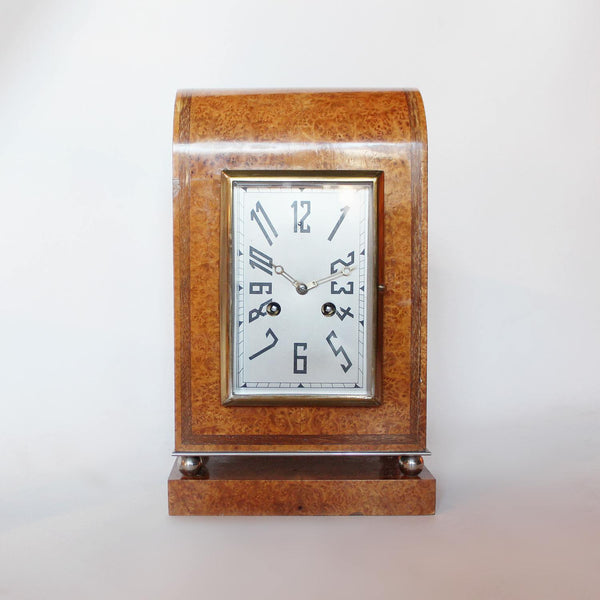 An Art Deco mantel clock in amboyna with metal face circa 1930 at Jeroen Markies