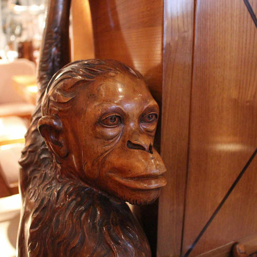 An unusual and unique Art Deco cocktail cabinet with hand carved monkeys