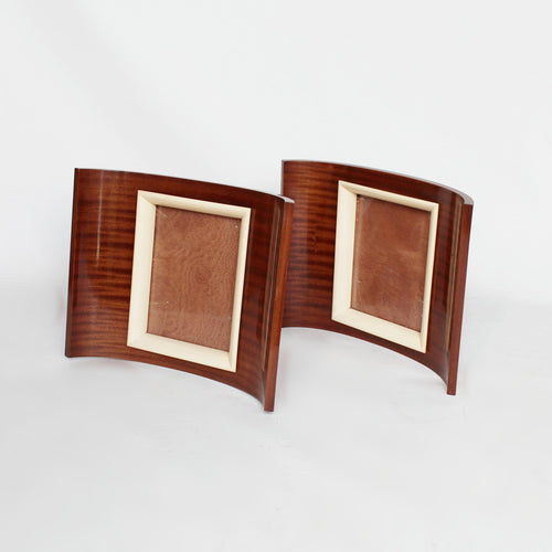 A pair of Art Deco curved wooden frames circa 1935