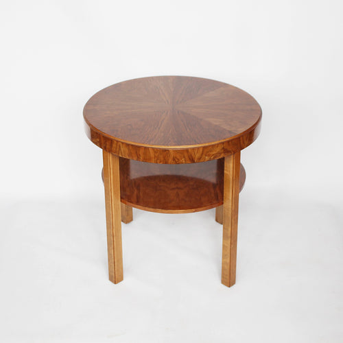 An Art Deco circular side table with shelf circa 1930