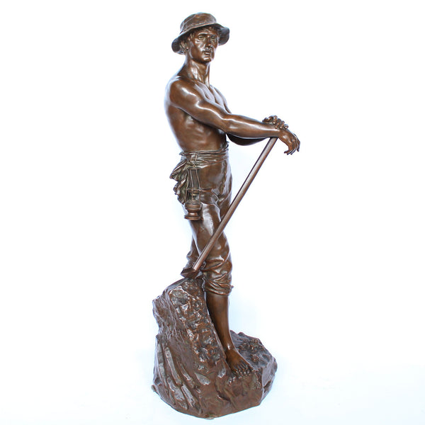 A large, bronze figure of  miner standing bare chested on an integral naturalistic base holding a pickaxe and a miner's lamp. Inscribed 'Mineur par Levy Salon des Beaux Arts', signed 'CH LEVY' and with the inscription: 'Bronze Garanti Au Titre L.V Deposee' at Jeroen Markies