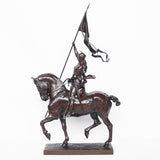 Jeanne d'Arc. A stunning early salon version of the famous Joan of Arc in the Place des Pyramides in Paris. Wonderful rich brown patina and stunning hand chased detail and characterisation. Set on an integral, naturalistic plinth. Signed E Fremiet to cast at Jeroen Markies