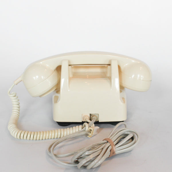 An original GPO model 706 telephone in cream at Jeroen Markies
