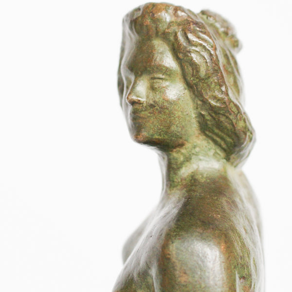 Venus, an Art Deco verdigris patinated and cold painted bronze sculpture. Depicts the figure of Venus emerging, set over a marble plinth. Chips to marble at Jeroen Markies