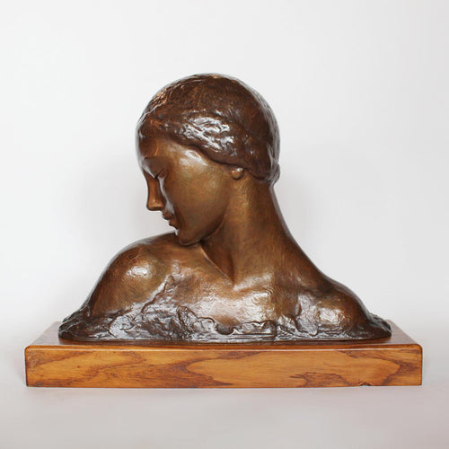 Amadeo Gennarelli Art Deco bronze bust of a young woman set over a wooden plinth at Jeroen Markies