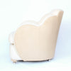A pair of Art Deco, cloud back armchairs, re-leathered in cream leather at Jeroen Markies.