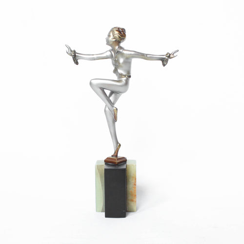 An Art Deco, cold painted bronze figure by Josef Lorenzl (1892-1950). A dancing woman in stylised pose set over a green onyx plinth at Jeroen Markies