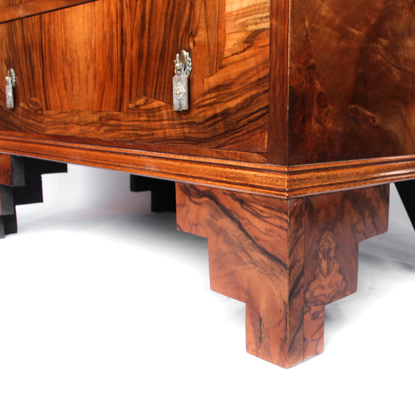 Art Deco walnut chest of drawers. Original gilt bronze handles. Mahogany lined drawers. Stepped bracket feet at Jeroen Markies.