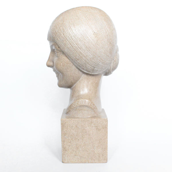 An Art Deco, stone carved sculpture of a smiling young lady, set over an integral plinth. Original dedication plaque to rear at Jeroen Markies.