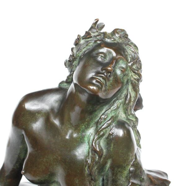 Clytie, a verdigris patinated bronze sculpture by François Louis Virieux (19th and 20thC). Depicts Clytie, the nymph infatuated with Helios, god of the sun. She eventually became a sunflower because, like the flower, she followed her unrequited love with her gaze wherever he went at Jeroen Markies.