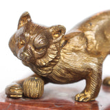 An Art Deco, gilt bronze sculpture of a cat playing with a ball of yarn. Set over a marble plinth and signed Richard to marble at Jeroen Markies